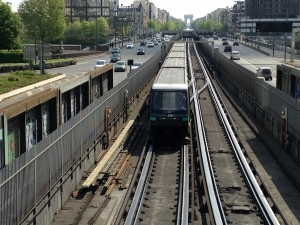 A train on the M1 line (the Arc de Triomphe is in the background, Neuilly in-between)