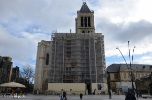 The front of the basilica, which is currently undergoing restoration. The city of Saint-Denis is supposedly attempting to secure financing for the reconstruction of the tower that was removed from the left side of the building (the stones are apparently stored on-site somewhere).