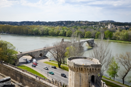 The remains of Pont Saint-Bénézet, as seen from atop the Avignon wall. The bridge originally terminated at the tower seen in the background.