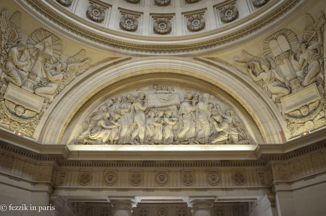 The bas-relief that depicts the movement of the royal remains from Madeleine cemetery to the basilique Saint-Denis.