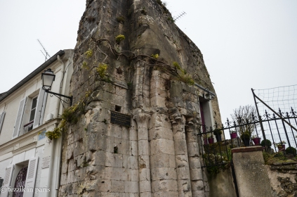 What's left of a church. Note the flower pots leading to the door.