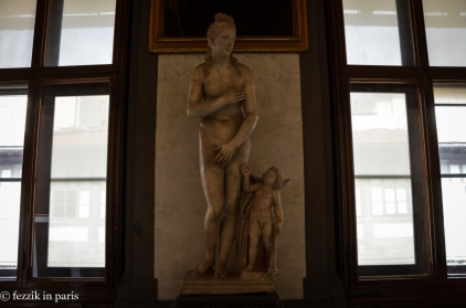I like the cherub, who appears to be telling her not to worry about having misplaced her clothes.