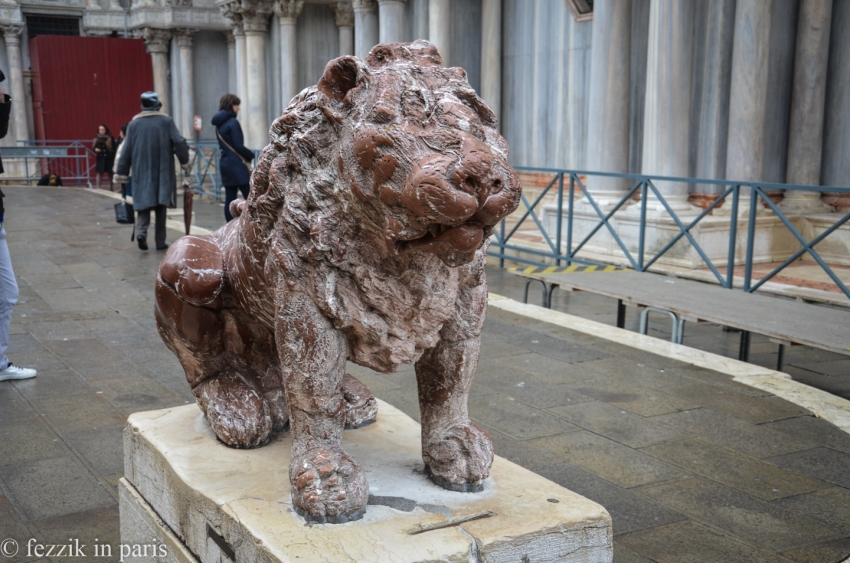A lion next to the basilica (not winged, however).