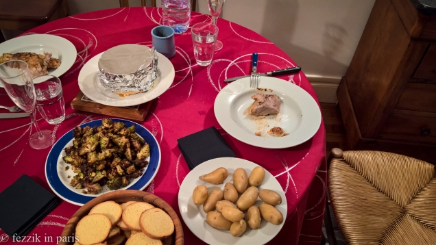 """Course five is the main course. Our canette was well cooked, if less """"ducky"""" than we prefer. The tinfoil-covered cylinder in the middle of the table contains mont d'or cheese, into which the romanesco, the potatoes, and a couple of pieces of duck were dipped."""
