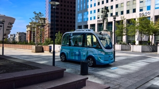 It's the autonomous all-electric shuttle that anger dings at pedestrians during the lunch rush hour.