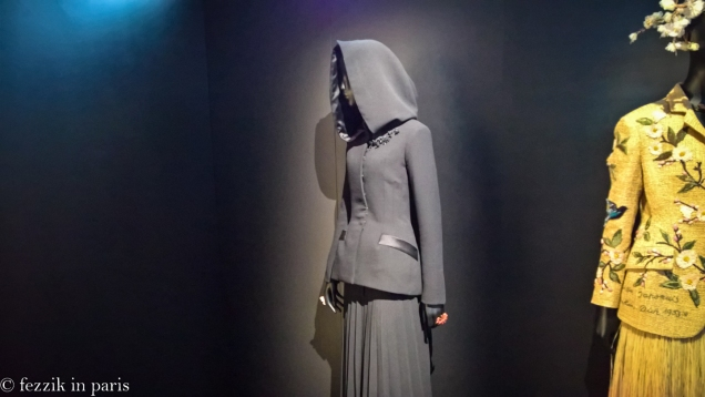A hooded dress from the person that currently heads the house.