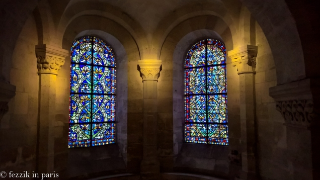 I don't usually expect crypts to have nice stained glass windows.