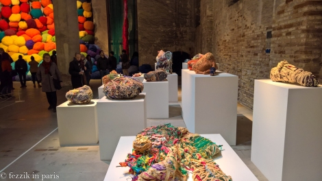 No lions in this biennale installation, but they would probably be enamored with those massive balls of yarn in the background.